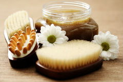 Body scrub. Jar of body scrub and massager - beauty treatment Royalty Free Stock Photos