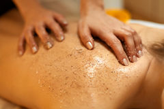 Body Scrub. Beautiful Blonde Gets a Salt Scrub Beauty Treatment Royalty Free Stock Images