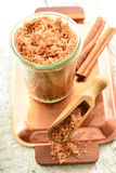 Body scrub - brown sugar with cinnamon. Royalty Free Stock Photography