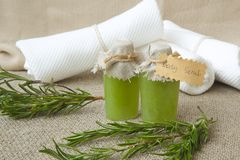 Body scrub with rosemary essential oil. Rosemary twigs in the background Royalty Free Stock Image
