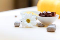 Body scrub. Salt Scrub and Chocolate Royalty Free Stock Images