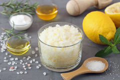 Body scrub of sea salt with lemon. Rosemary and olive oil homemade cosmetic for Spa care Stock Photography