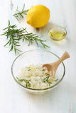 Body scrub of sea salt with lemon. Rosemary and olive oil homemade cosmetic for Spa care Royalty Free Stock Images