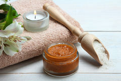 Body scrub and sea salt. On a wooden background. Spa concept Stock Photo