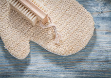 Body scrubber bath brush on wooden board sauna concept Royalty Free Stock Image