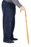 Body of senior man leaning on cane Royalty Free Stock Image