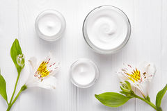Body shaping cosmetic cream lotion anti cellulite skin shape care leg treatment spa wellness massage healthy moisurizer. Organic product with flowers on white Stock Images