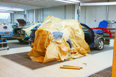 Body shop. The image of cars stand under repair in body shop Royalty Free Stock Photos