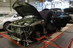 Body shop. The image of cars stand under repair in body shop Stock Photos