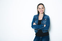 Body Shot of a Cheerful Woman in Denim jacket Royalty Free Stock Images