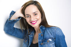 Body Shot of a Cheerful Woman in Denim jacket Stock Photo