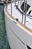 Body side of yacht in harbor. A yacht stop in harbor, shown as marine activity, travel or in maintenance Stock Photo