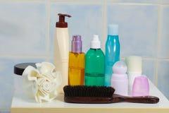 Toiletries in bathroom on shelf Stock Photos