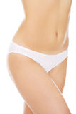 Body of slim young woman in white underwear Royalty Free Stock Images