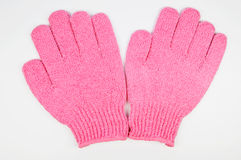 Body-smoothing scrub gloves Stock Photos