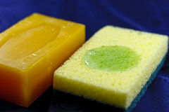 Bar of Soap and Scrubbing Sponge Stock Photography