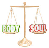 Body and Soul Words Scale Balance Weighing Total Health. The words Body and Soul weighed on a scale in perfect balance to illustrate the goal of complete health Stock Image