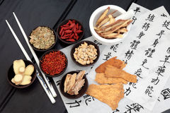 Body and Spirit Health. Traditional chinese herbal medicine selection with mandarin calligraphy on rice paper. Translation describes the medicinal functions to Stock Photos