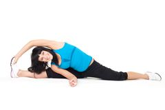 Body stretching sitting on splits Stock Photos