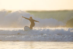 Body surfer riding a perfect wave. Stock Photos