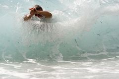 Body surfing. Man is swimmining in the waves Royalty Free Stock Photography