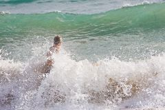 Body Surfing in tropical waves Stock Image