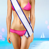 Body with tape of beauty contest. Woman's shape with white tape of beauty contest stock photo