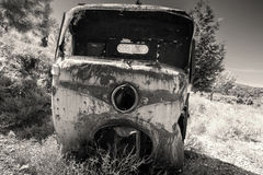 Body of three-wheeled light commercial vehicle. Abandoned rusted body of three-wheeled light commercial vehicle, old style filter effect, monochrome retro photo stock photos
