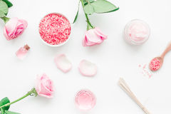 Body treatment with rose flowers and cosmetic set white desk background top view Stock Photo