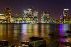 Body of Water Across City Buildings during Night Royalty Free Stock Image