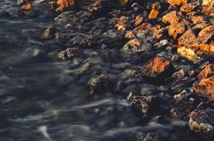 Body of Water on Brown Rock during Daytime Royalty Free Stock Photos