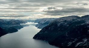 Body of Water Between Mountains Stock Photo