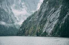 Body of Water Between Mountains Royalty Free Stock Images