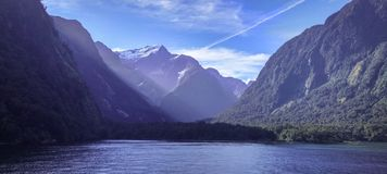 Body Of Water Near Mountain Under Clear Sky Stock Photography