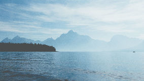 Body of Water Near Mountains during Daytime Stock Images