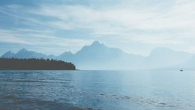 Body of Water Near Mountains during Daytime Royalty Free Stock Images