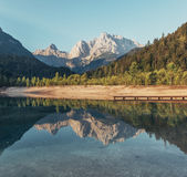 Body of Water Near Mountains Under Blue Sky Photo Royalty Free Stock Photos