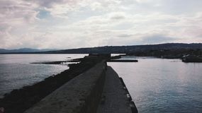 Body of Water Near to Seawall Royalty Free Stock Photos
