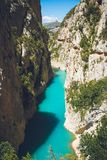 Body of Water in Between of Rock Formation Under Blue Sky at Daytime Royalty Free Stock Images