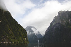 Body of Water Surrounded by Mountain Royalty Free Stock Photos