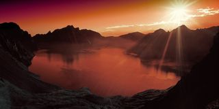 Body of Water Surrounded by Mountains during Sun Set Stock Photos