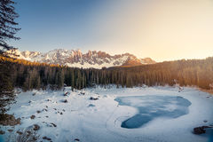 Body of Water Surrounded by Snow Near Trees during Daytime Royalty Free Stock Photo