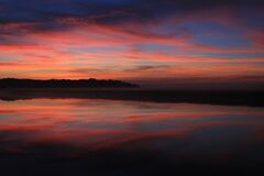 Body of Water Under Blue Red and Yellow Sunset Sky Stock Photo