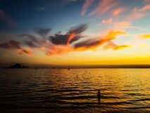 Body of Water Under Calm Sky during Golden Hour royalty free stock photo