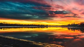 Body of Water Under by Cirrus Clouds during Golden Hour Stock Photo