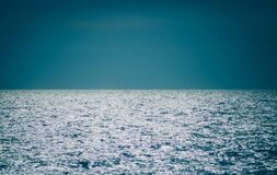 Body of Water Under Clear Blue Sky Stock Photography