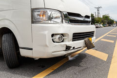 Body of white van get damaged by accident. Body of blue car get damaged Stock Photo