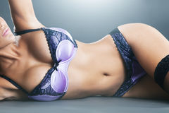 Body of woman with long hair in purple lingerie Royalty Free Stock Image