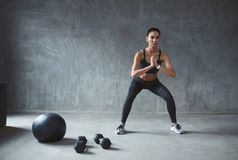 Body Workout. Fitness Woman In Stylish Sports Clothes Exercising royalty free stock photos