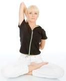Body yoga exercise. Beautiful young blondy doing yoga exercise stock images